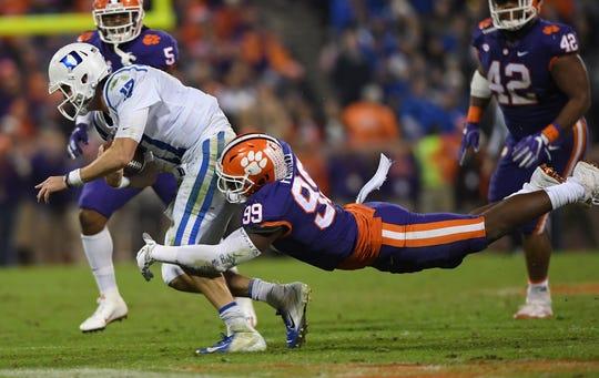 Clemson defensive lineman Clelin Ferrell (99) sacks Duke quarterback Daniel Jones (17) during the 2nd quarter Saturday, November 17, 2018 at Clemson's Memorial Stadium.