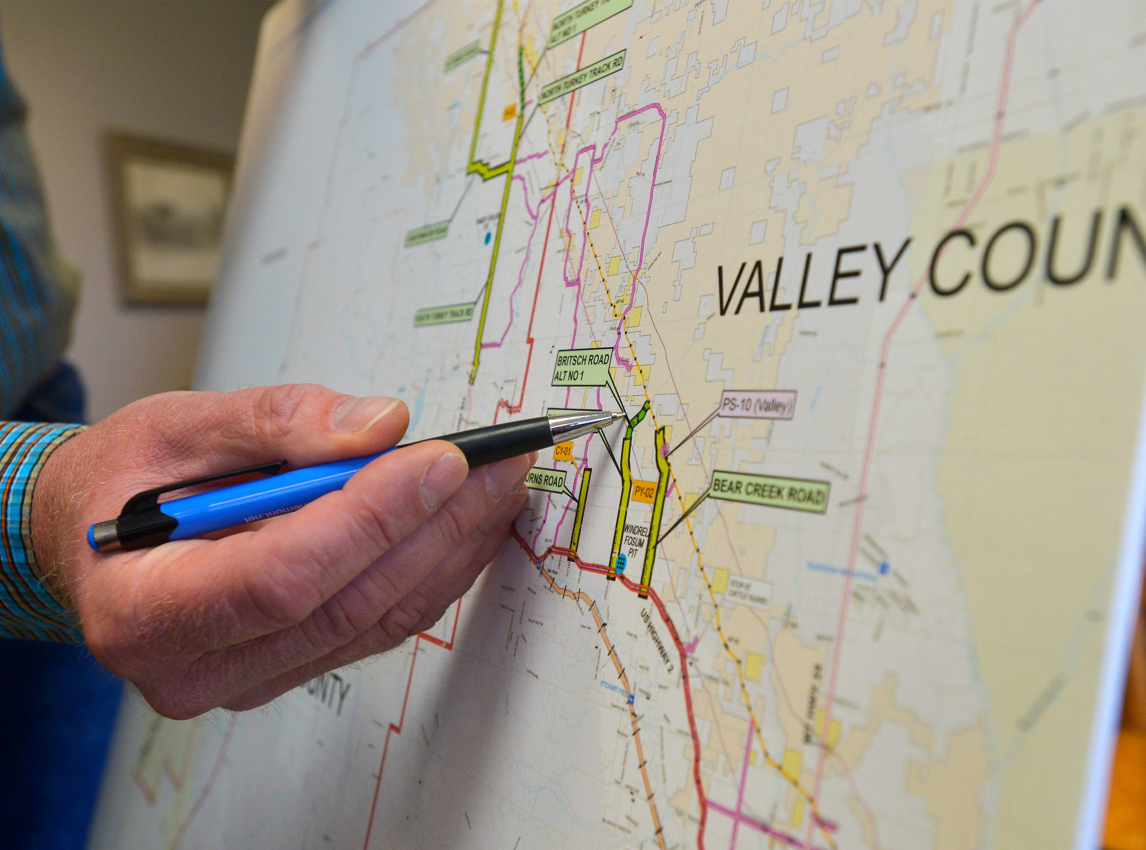 Valley County Commissioner Paul Tweten points locations of the Keystone XL Pipeline infrastructure in Valley County.