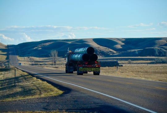 A pipe truck travels down the highway between Fort Peck and Glasgow in October.