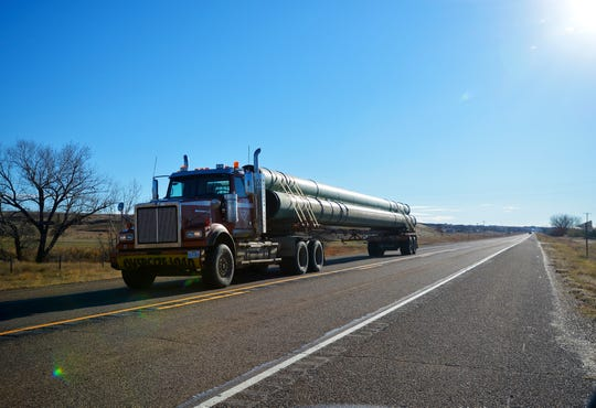 Semi-trailer truck loaded with 36-inch pipe for the Keystone XL Pipeline heads west on U.S. Highway 2 between Hinsdale and Glasgow, Mont., en route to a pipe yard in northern Phillips County.