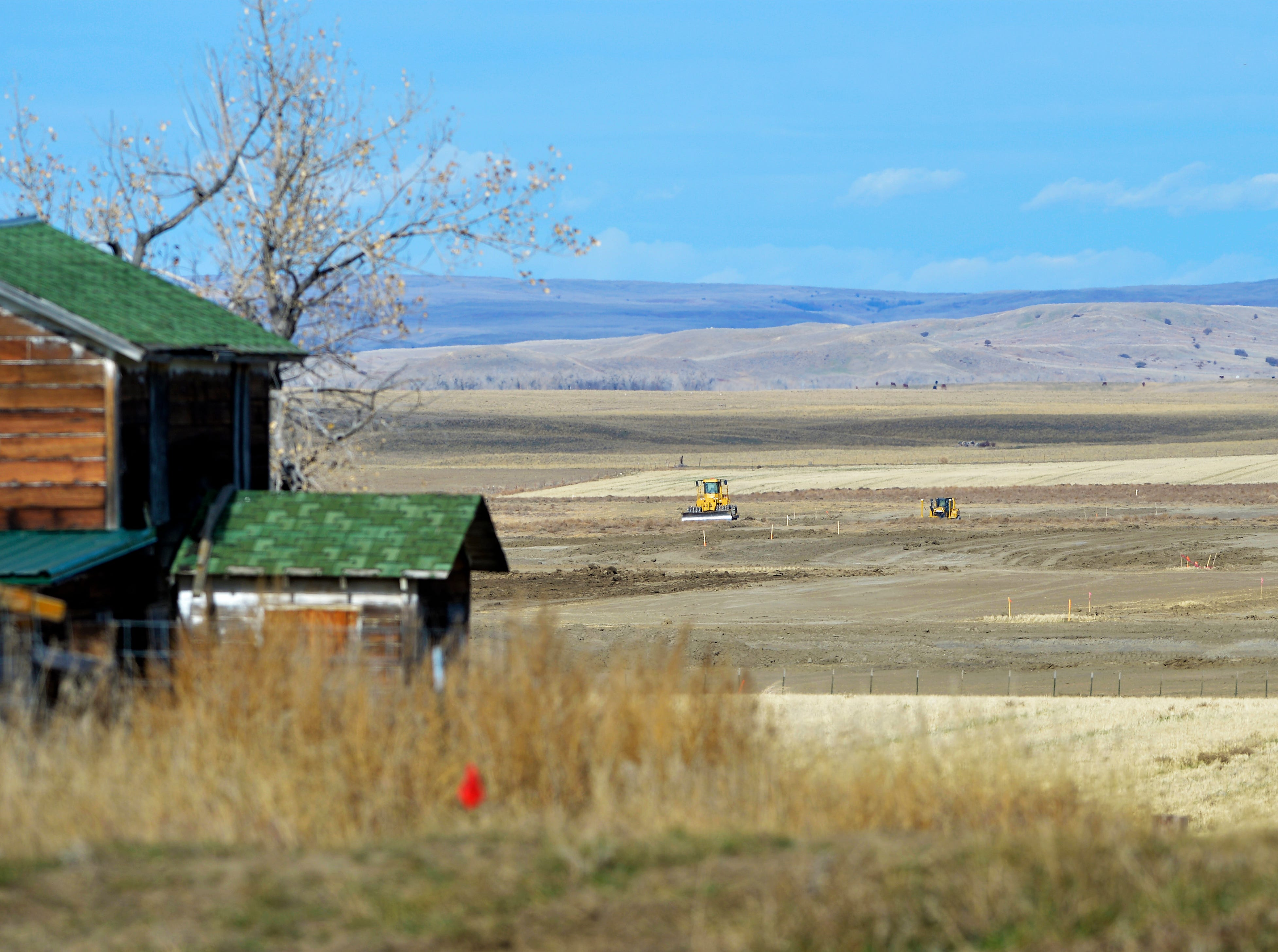 An old farm house overlooks a field that will be used for the site of a construction camp where workes will stay during construction of the Keystone XL Pipeline in Valley County.  Temporary work camps will be constructed to meet the housing needs of the construction workforce in remote locations.