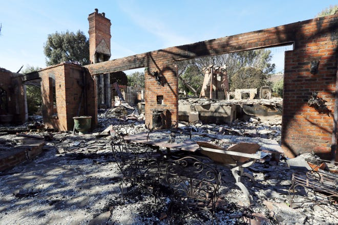 FILE - This Tuesday, Nov. 13, 2018 file photo shows the Malibu, Calif., villa of German TV presenter Thomas Gottschalk lying in ruins from the Woolsey fire. Craig Williams, the chief of Evergreen, Mont., Fire Rescue, has been assisting firefighters in Malibu. He told the Flathead Beacon on Friday, Nov. 16, that the devastating fires hitting California could happen in Montana and the state's residents should be prepared. (AP Photo/Reed Saxon, File)
