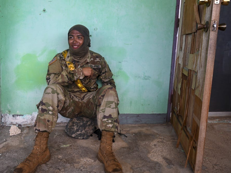 Sgt. Ken Orejola, 721st Army Band, takes a break during a lull in debris clearing operations in the village of Chalan Konoa, Saipan, Commonwealth of the Northern Mariana Islands, Nov. 17, 2018, in support of the Super Typhoon Yutu relief efforts.