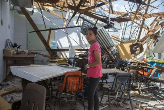 A sixth grader at Hopwood Middle School visits her mathematics classroom after Super Typhoon Yutu made landfall, severely damaging the school. The school is temporarily closed as the village works together with the Commonwealth, voluntary organizations, and federal agencies to cleanup and restore the classrooms.