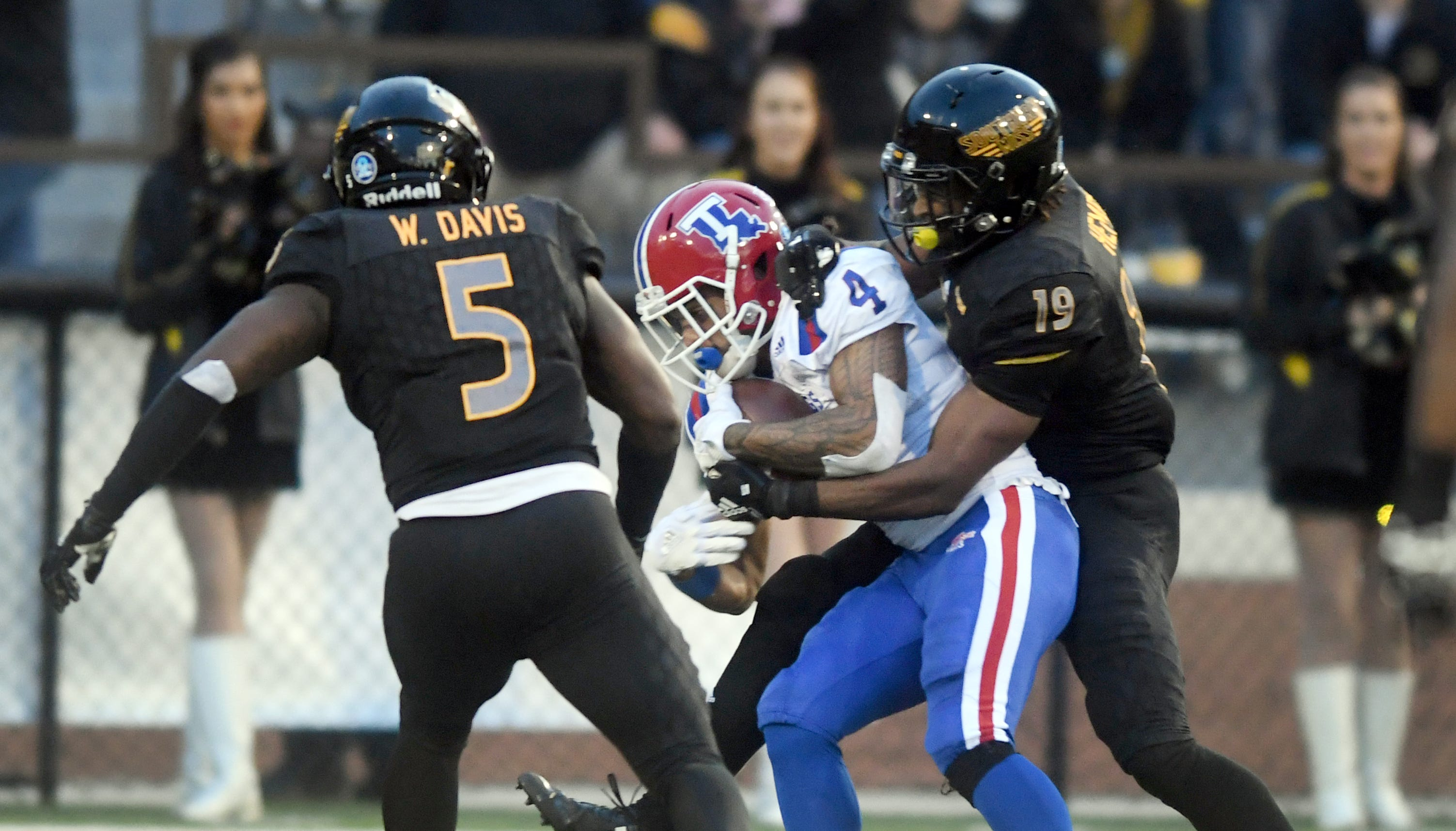 Southern Miss defenders Ky'el Hemby (19) and Waiden Davis (5) stop a player in a game against Louisiana Tech at M.M. Roberts Stadium on Saturday, November 17, 2018.
