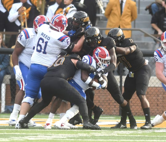 The Southern Miss defense makes a stop in a game against Louisiana Tech at M.M. Roberts Stadium on Saturday, November 17, 2018.