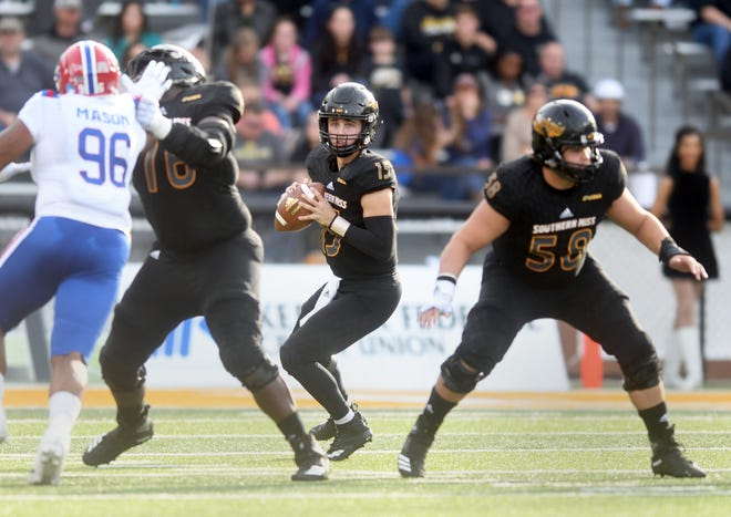 Southern Miss quarterback Jack Abraham looks for a receiver in a game against Louisiana Tech at M.M. Roberts Stadium on Saturday, November 17, 2018.