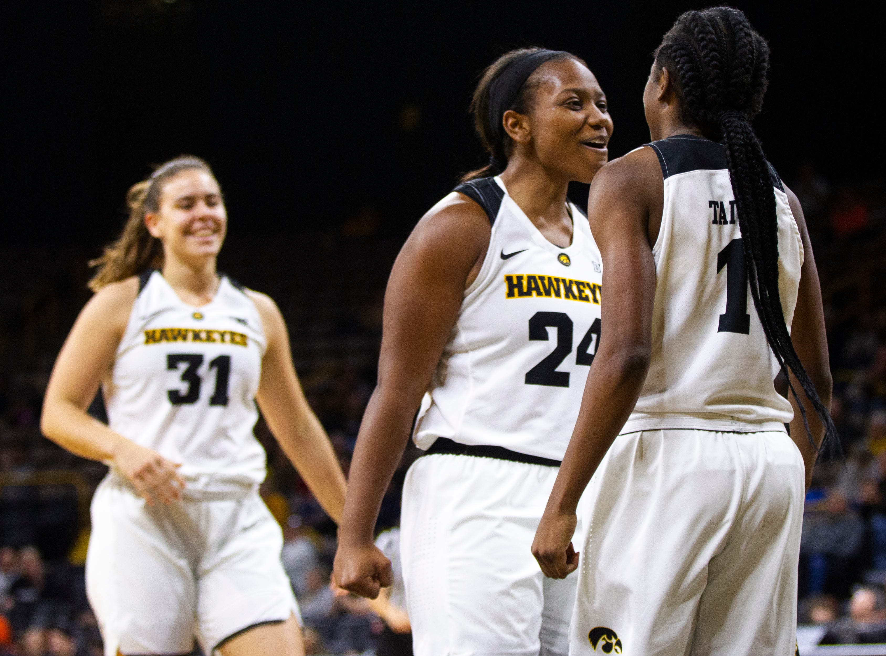 Iowa guard Zion Sanders (24) celebrates with Iowa guard Tomi Taiwo (1) after Taiwo drew a foul during an NCAA women's basketball game on Saturday, Nov. 17, 2018, at Carver-Hawkeye Arena in Iowa City.