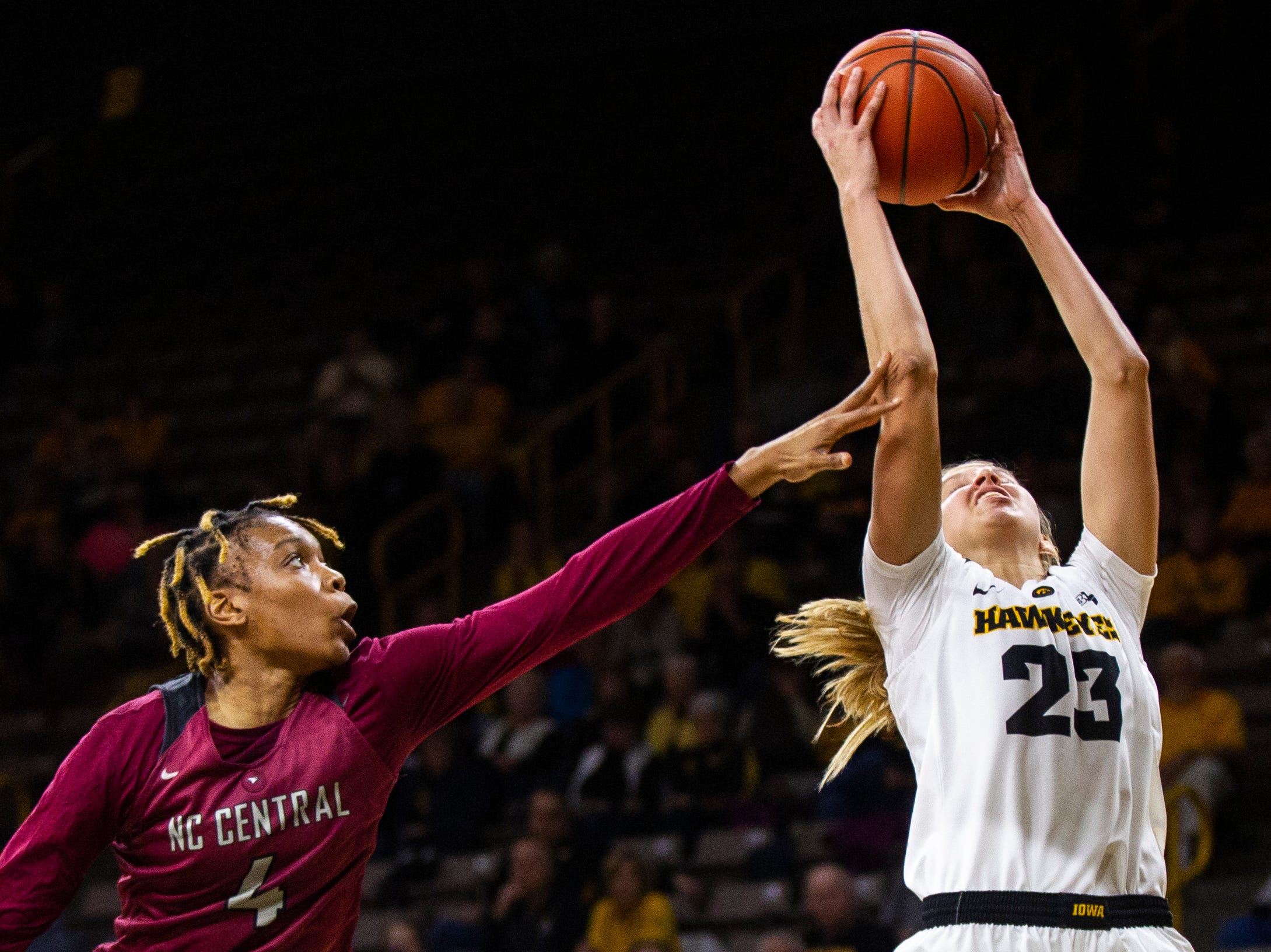 Iowa forward Logan Cook (23) grabs a defensive rebound past North Carolina Central's Paulina Afriyie (4) during an NCAA women's basketball game on Saturday, Nov. 17, 2018, at Carver-Hawkeye Arena in Iowa City.