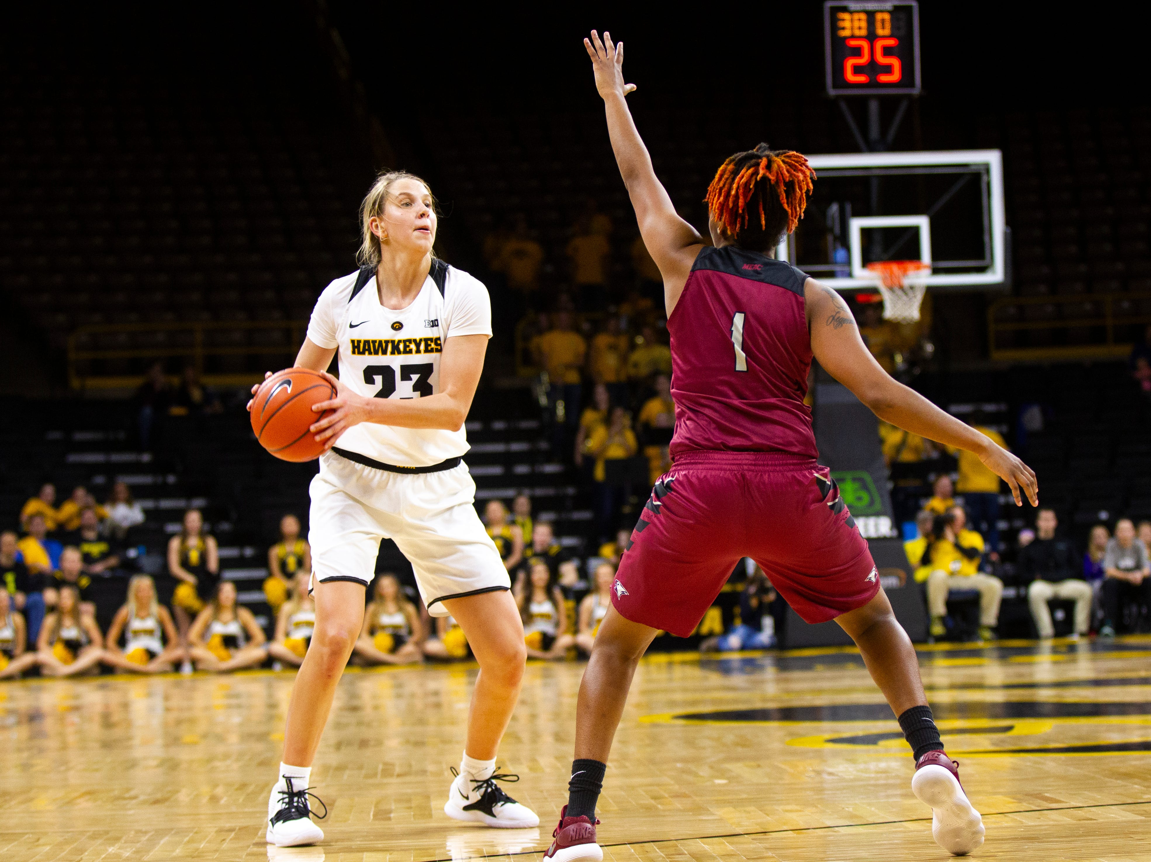 Iowa forward Logan Cook (23) looks to pass while being defended by North Carolina Central's Dasmine Kasey (1) during an NCAA women's basketball game on Saturday, Nov. 17, 2018, at Carver-Hawkeye Arena in Iowa City.
