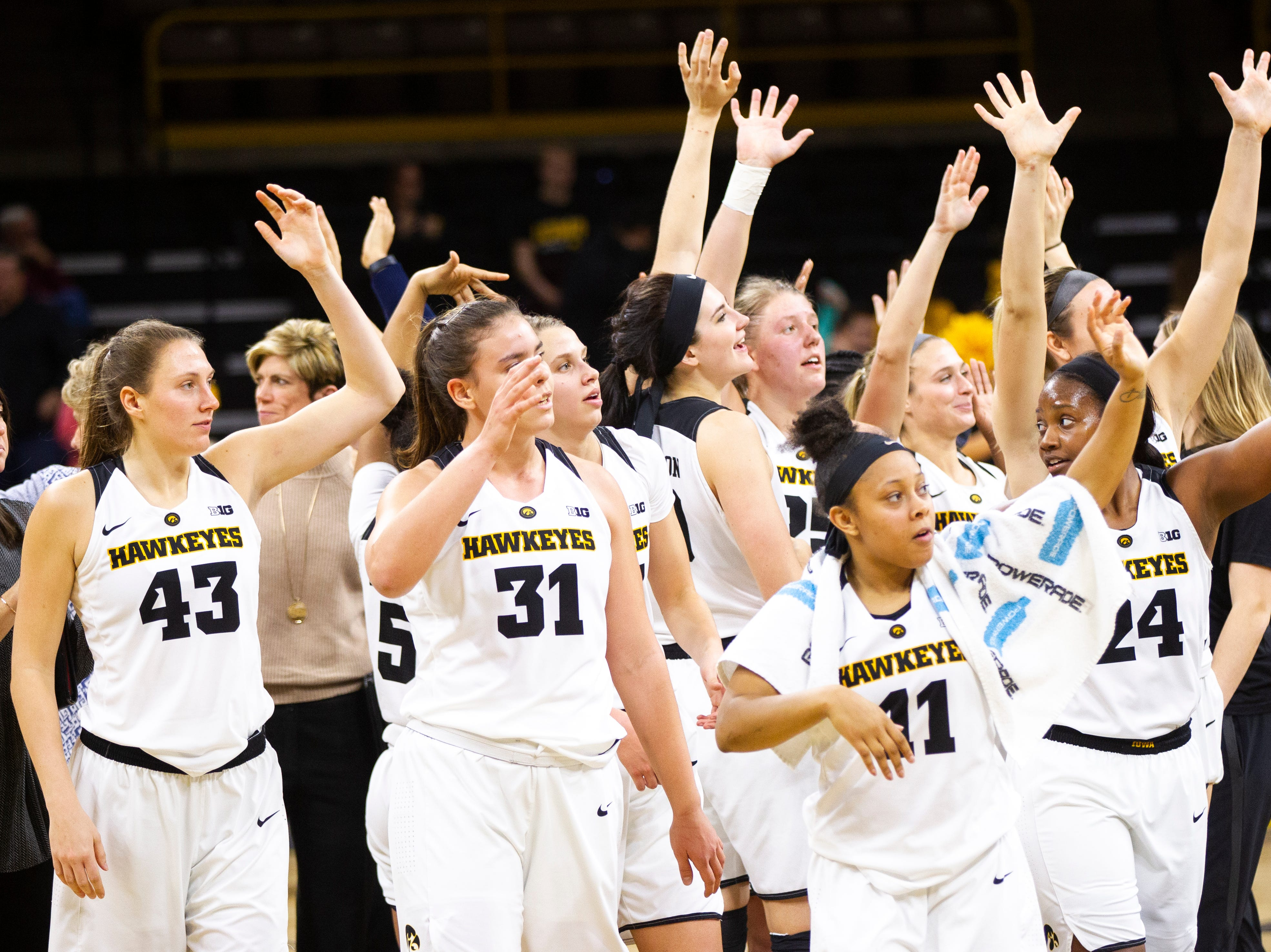 Iowa Hawkeyes players wave to fans after an NCAA women's basketball game on Saturday, Nov. 17, 2018, at Carver-Hawkeye Arena in Iowa City.