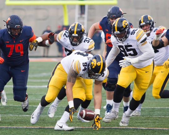 Nov 17, 2018; Champaign, IL, USA; Iowa Hawkeyes defensive end A.J. Epenesa (94) recovers a fumble during the second quarter against the Illinois Fighting Illini at Memorial Stadium.