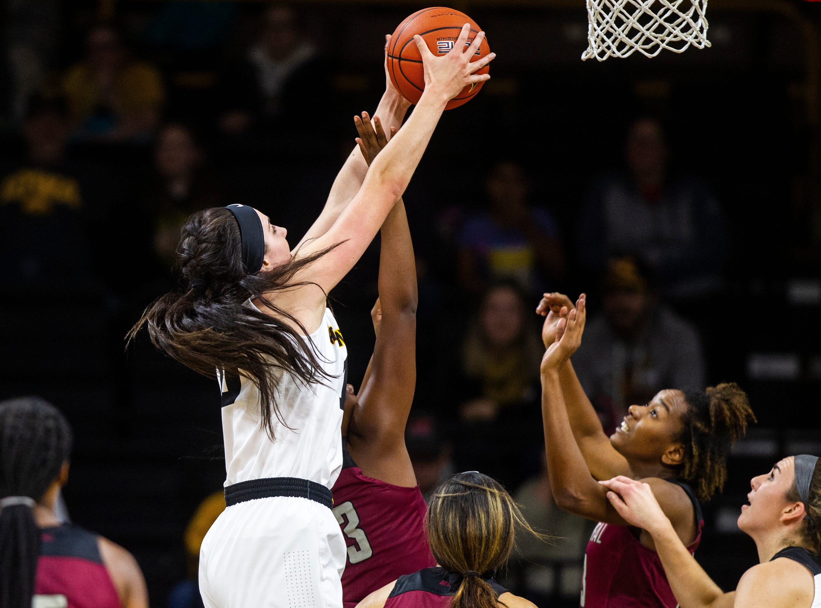 Iowa forward Megan Gustafson (10) grabs a defensive rebound during an NCAA women's basketball game on Saturday, Nov. 17, 2018, at Carver-Hawkeye Arena in Iowa City.