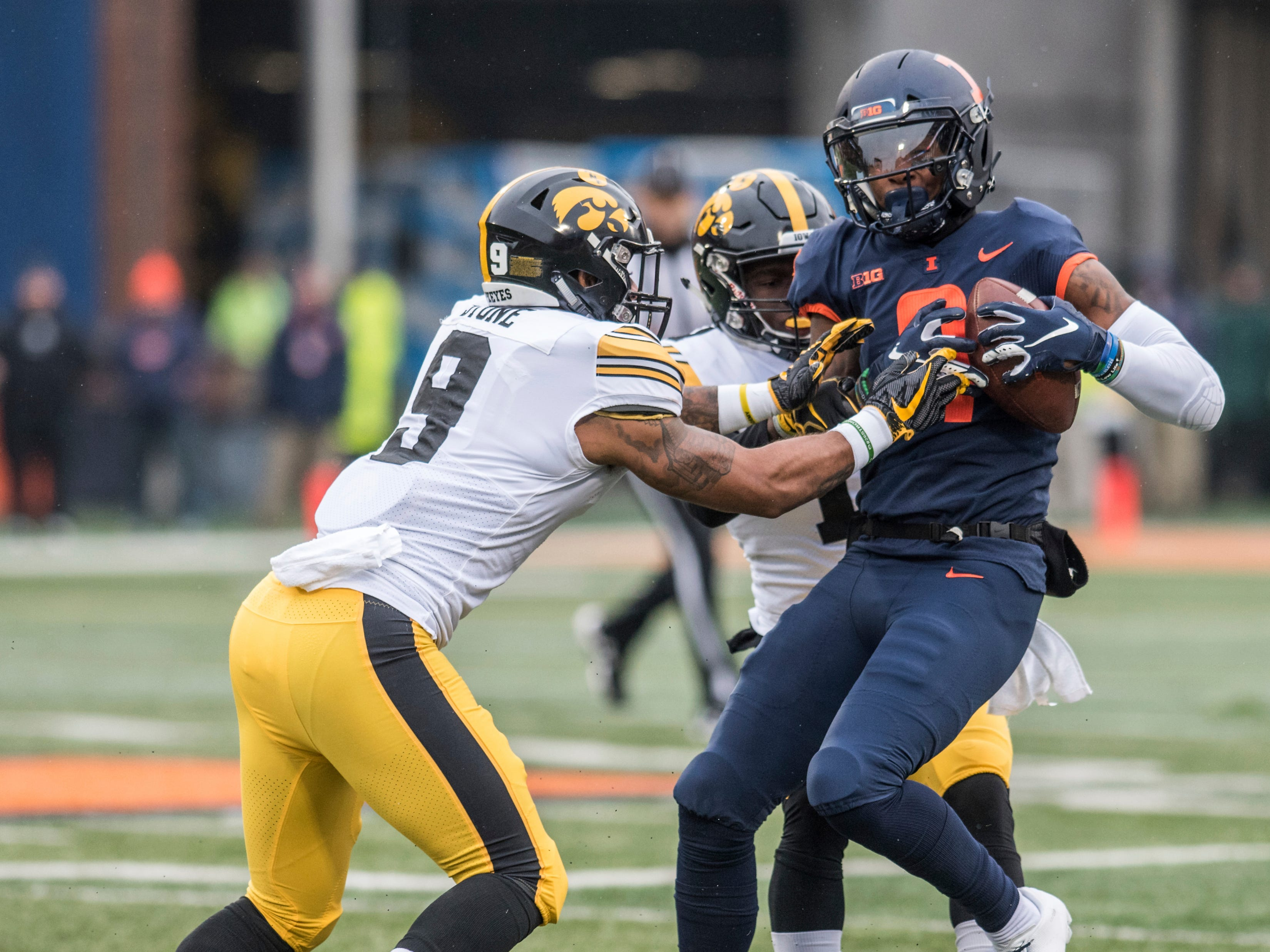 Illinois's Sam Mays (9) is tackled by Iowa's Geno Stone (9) after making a reception in the first half of a NCAA college football game Saturday, Nov. 17, 2018, in Champaign, Ill.