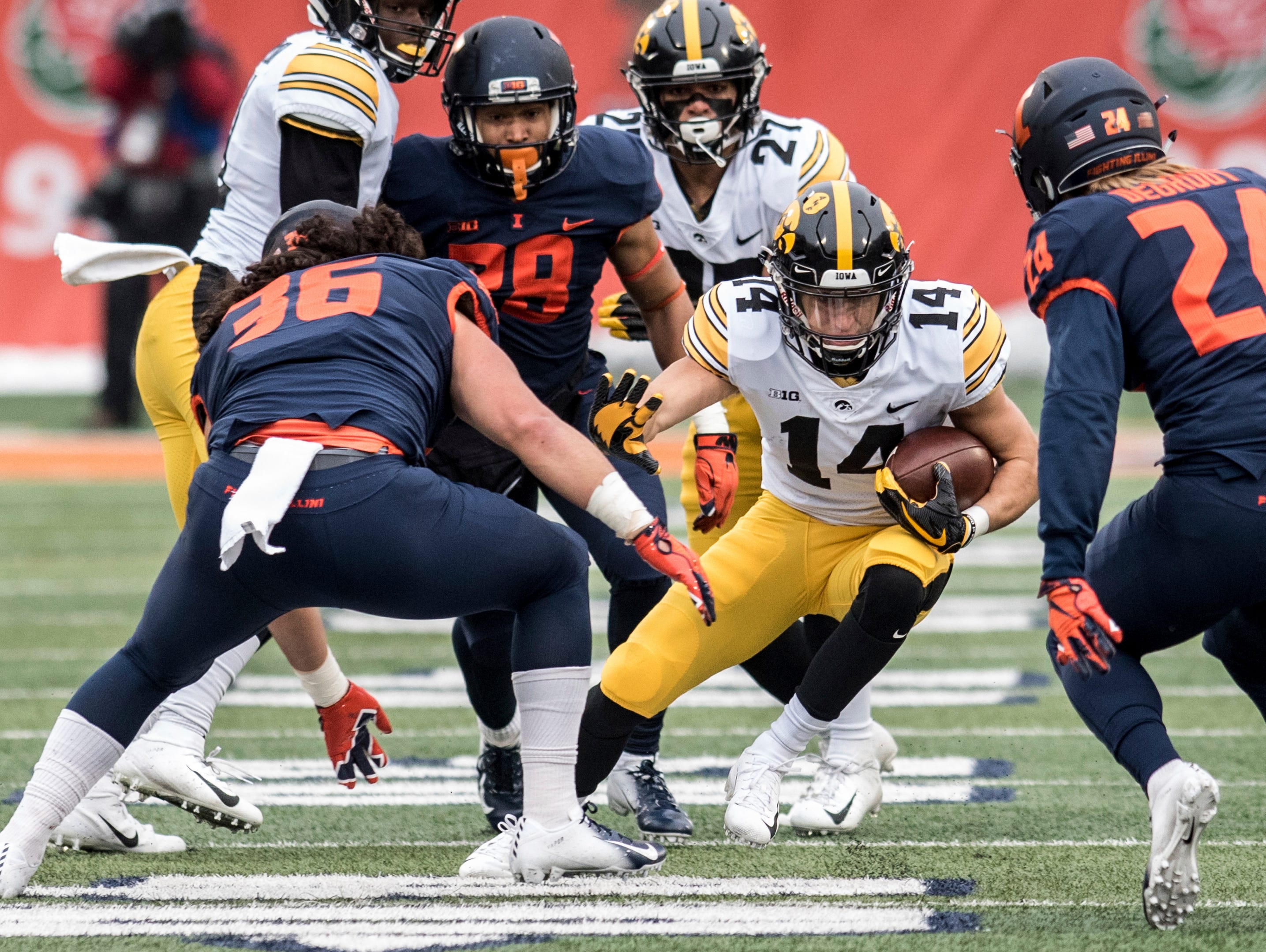 Iowa's Kyle Groeneweg (14) returns the ball against Illinois in the first half of a NCAA college football game, Saturday, Nov. 17, 2018, in Champaign, Ill.