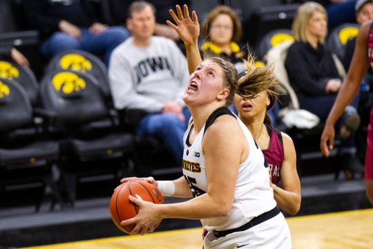 Iowa's Monika Czinano (25) attempts a shot during an NCAA women's basketball game on Saturday, Nov. 17, 2018, at Carver-Hawkeye Arena in Iowa City.