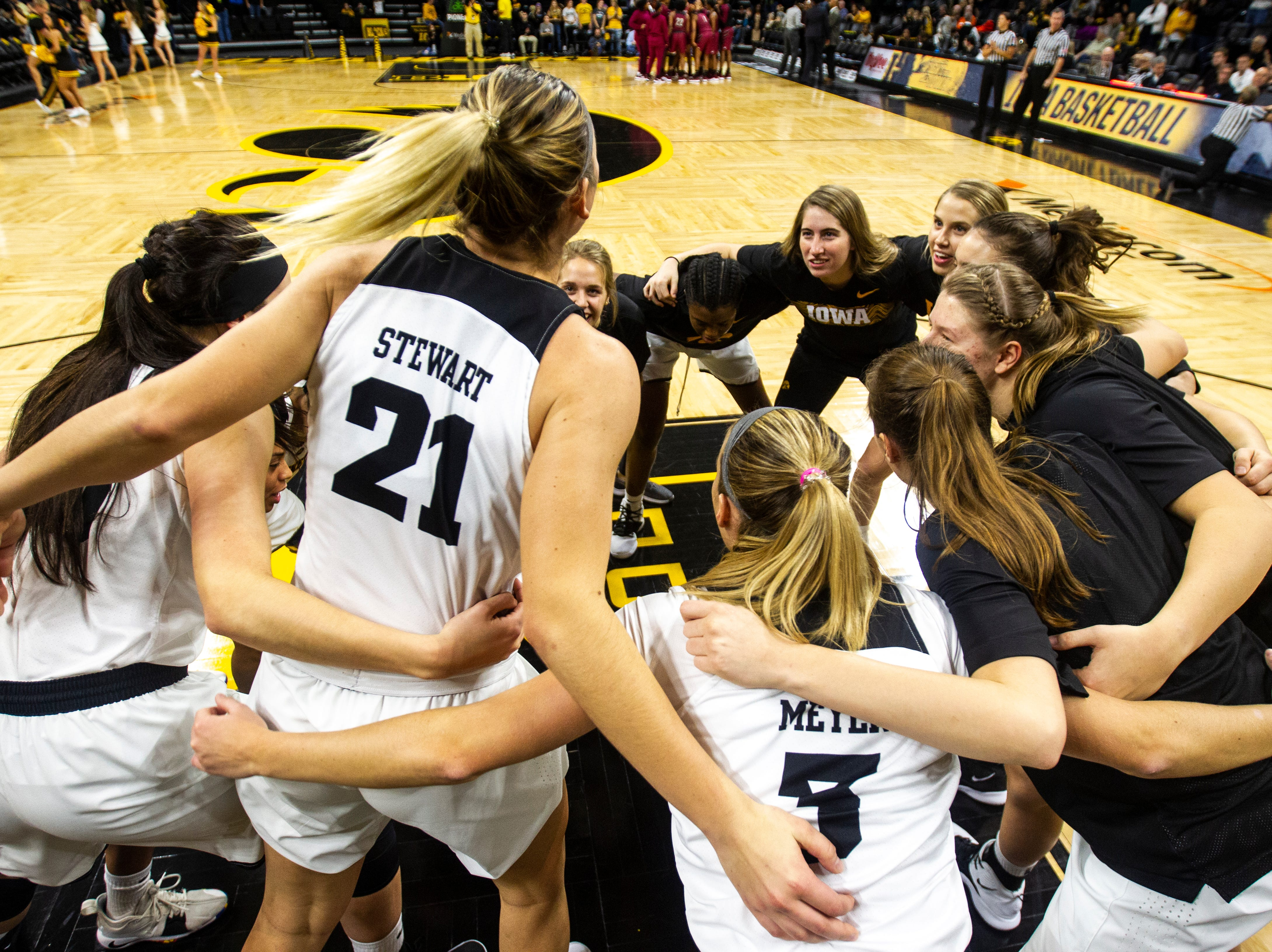 Iowa Hawkeyes players huddle before an NCAA women's basketball game on Saturday, Nov. 17, 2018, at Carver-Hawkeye Arena in Iowa City.