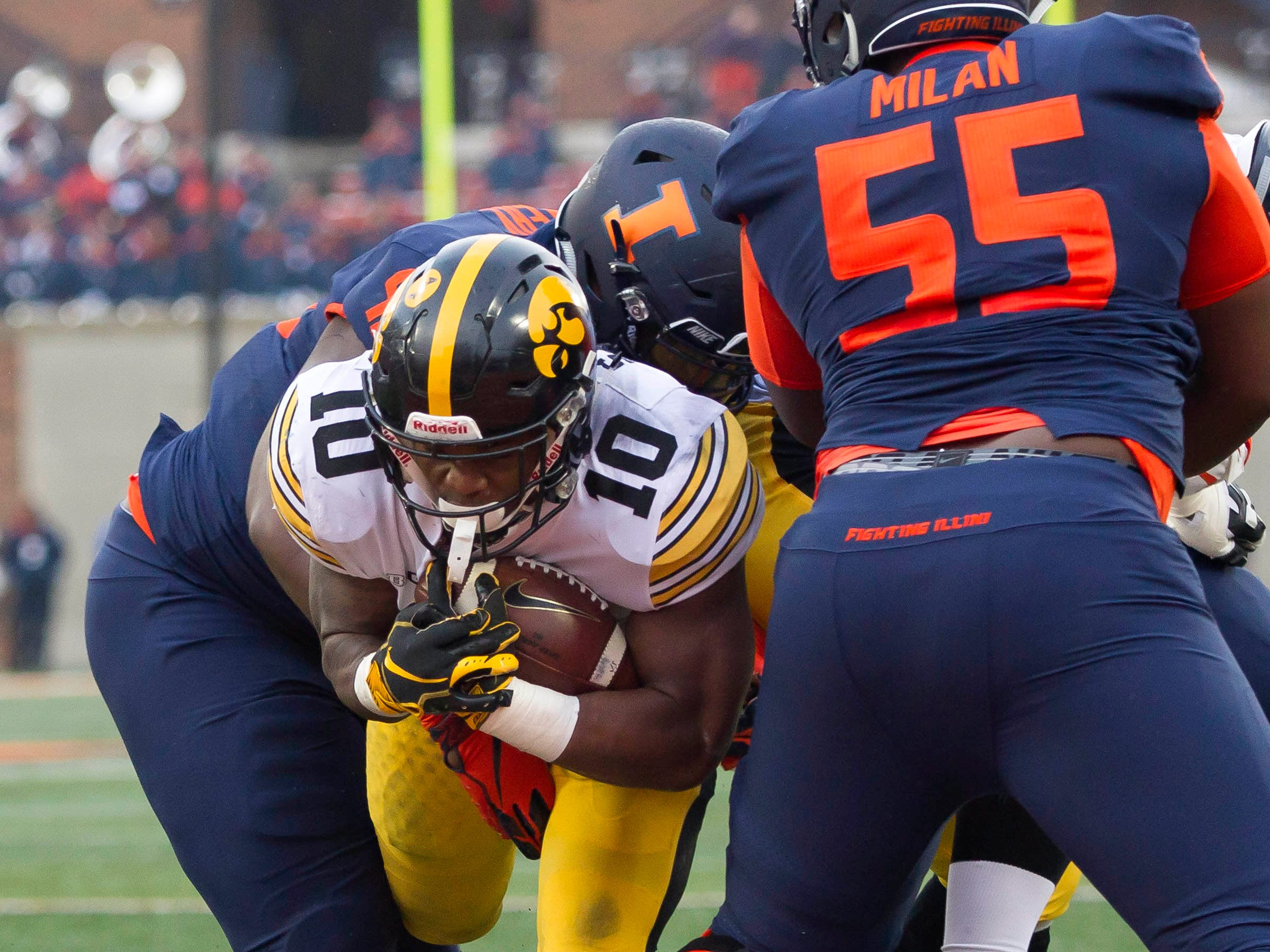 Nov 17, 2018; Champaign, IL, USA; Iowa Hawkeyes running back Mekhi Sargent (10) scores a touchdown during the second quarter against the Illinois Fighting Illini at Memorial Stadium.