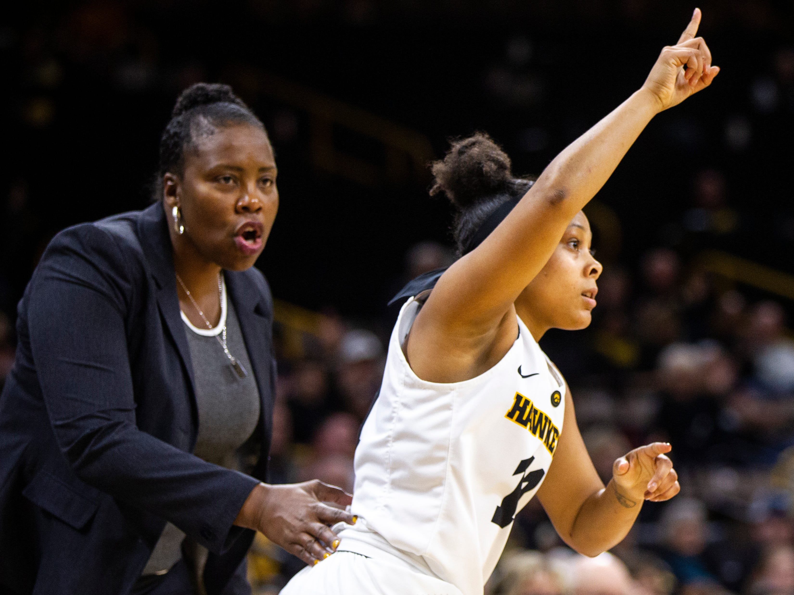 Iowa guard Tania Davis (11) gestures after making a 3-point basket in front of North Carolina Central head coach Trisha Stafford-Odom during an NCAA women's basketball game on Saturday, Nov. 17, 2018, at Carver-Hawkeye Arena in Iowa City.