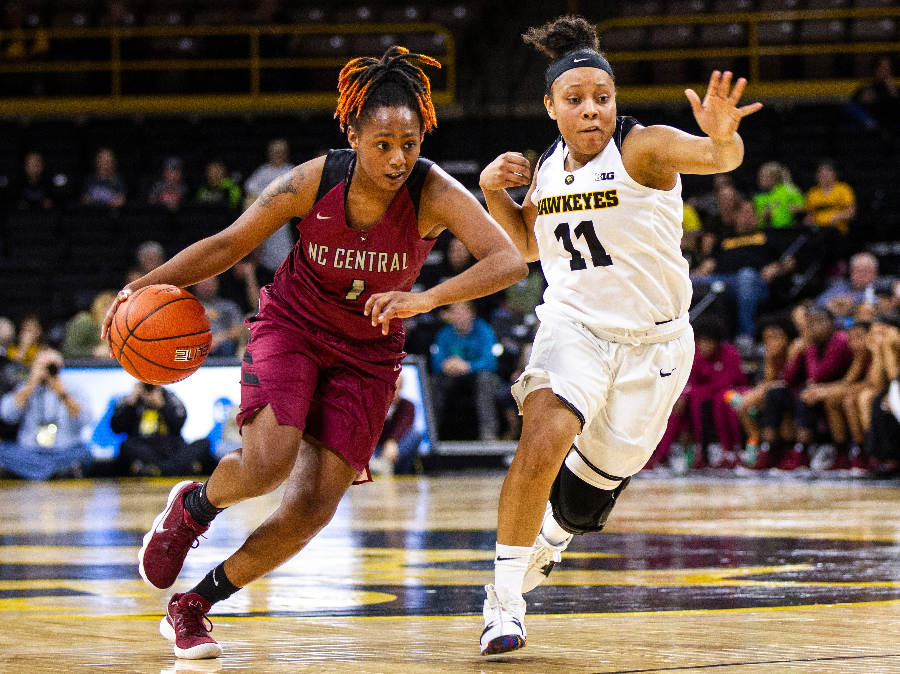 Iowa guard Tania Davis (11) defends North Carolina Central's Dasmine Kasey (1) during an NCAA women's basketball game on Saturday, Nov. 17, 2018, at Carver-Hawkeye Arena in Iowa City.