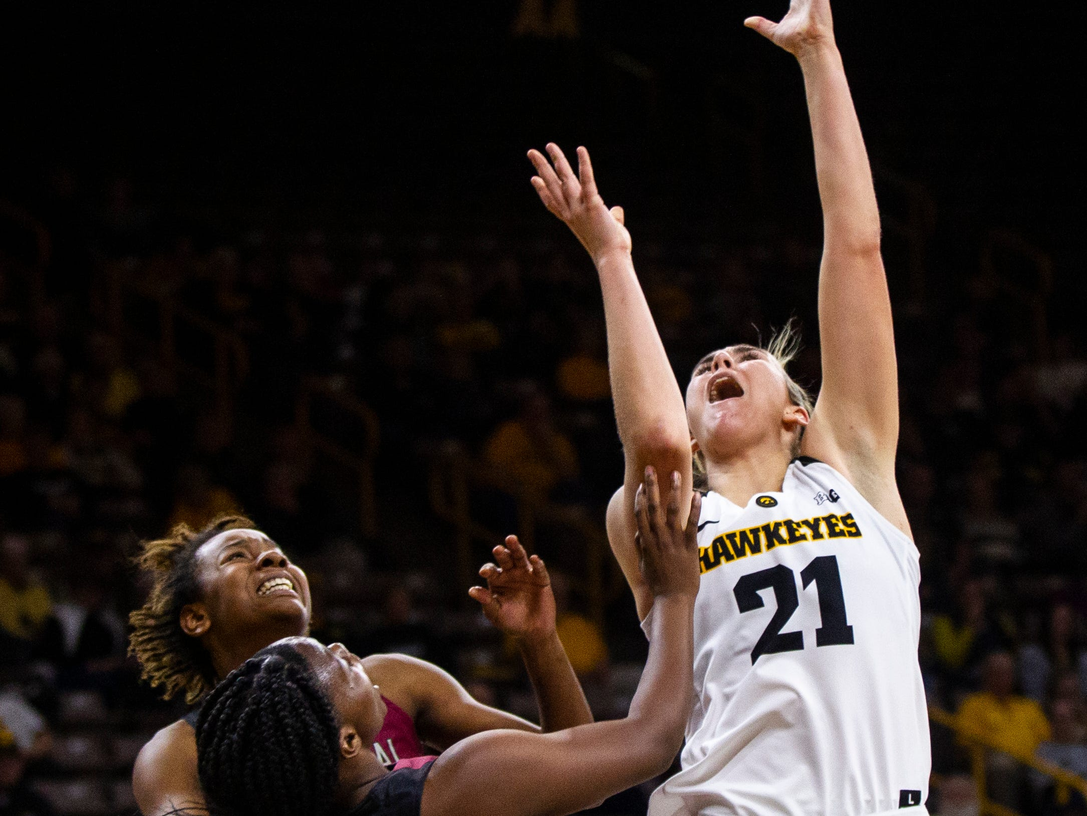 Iowa forward Hannah Stewart (21) attempts a shot during an NCAA women's basketball game on Saturday, Nov. 17, 2018, at Carver-Hawkeye Arena in Iowa City.