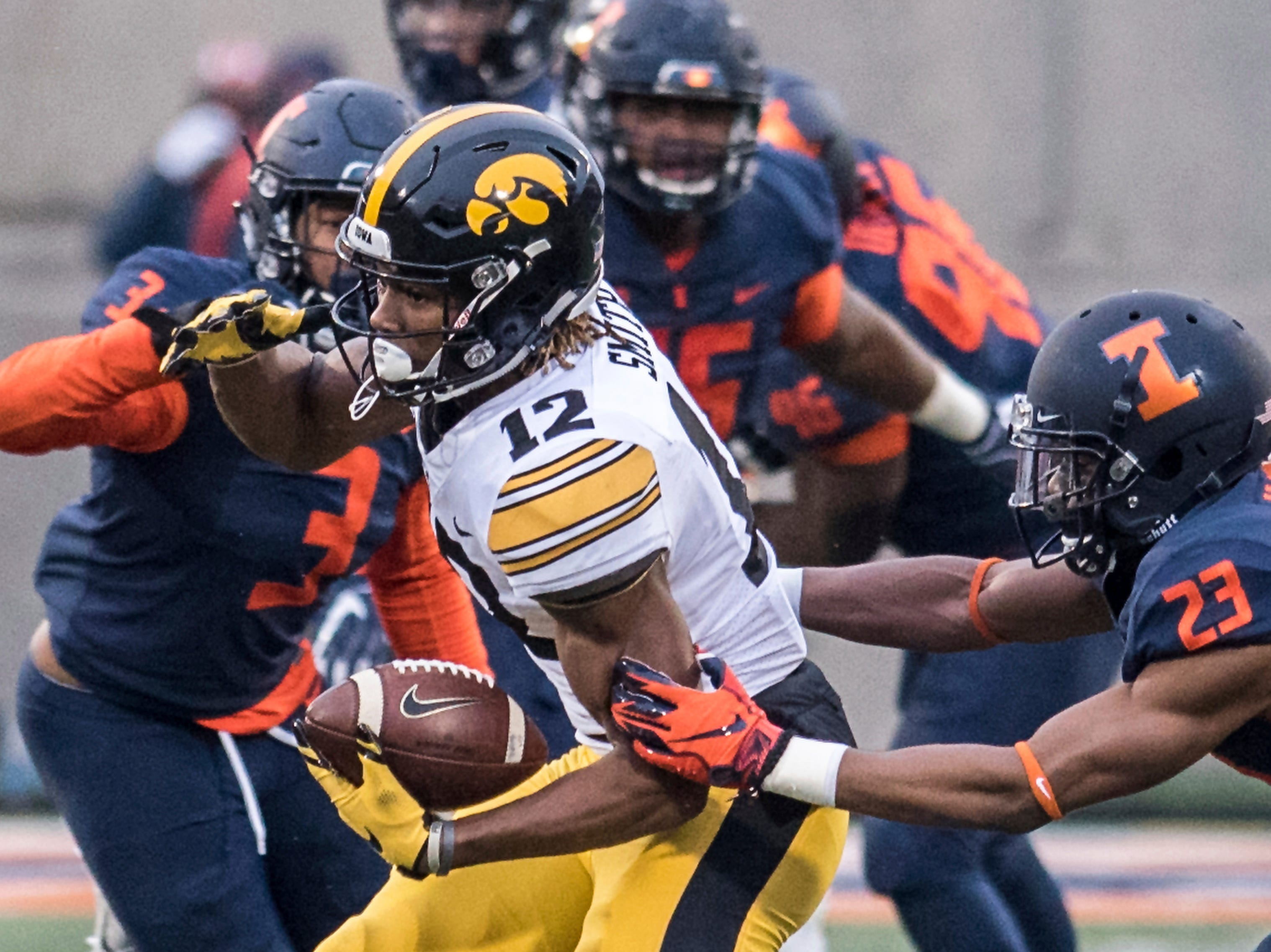 Iowa's Brandon Smith runs with the ball in the first half of a NCAA college football game against Illinois, Saturday, Nov. 17, 2018, in Champaign, Ill.