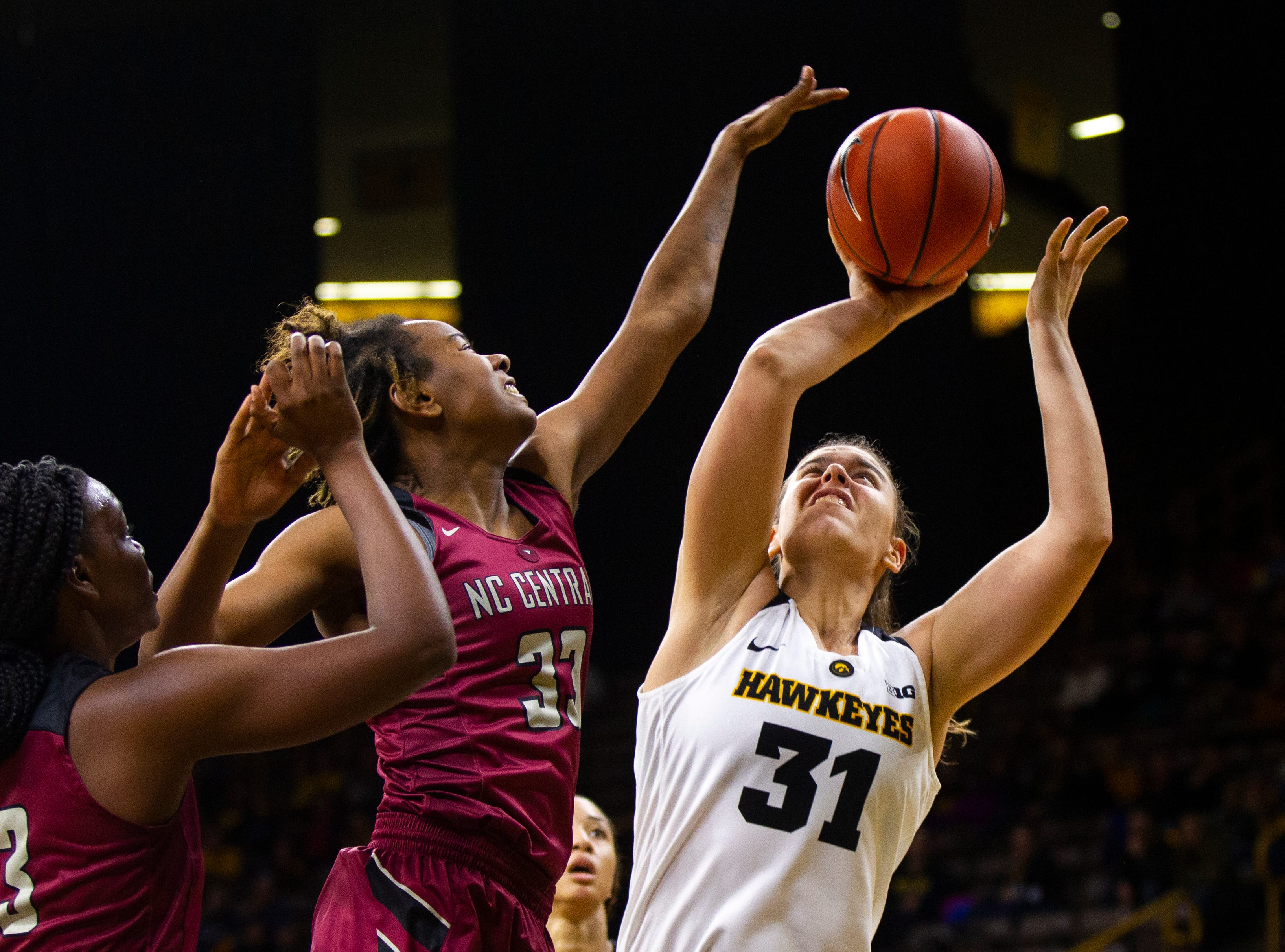 Iowa's Paula Valino Ramos (31) attempts a shot while being defended by North Carolina Central's Kiyana Bown (31) during an NCAA women's basketball game on Saturday, Nov. 17, 2018, at Carver-Hawkeye Arena in Iowa City.