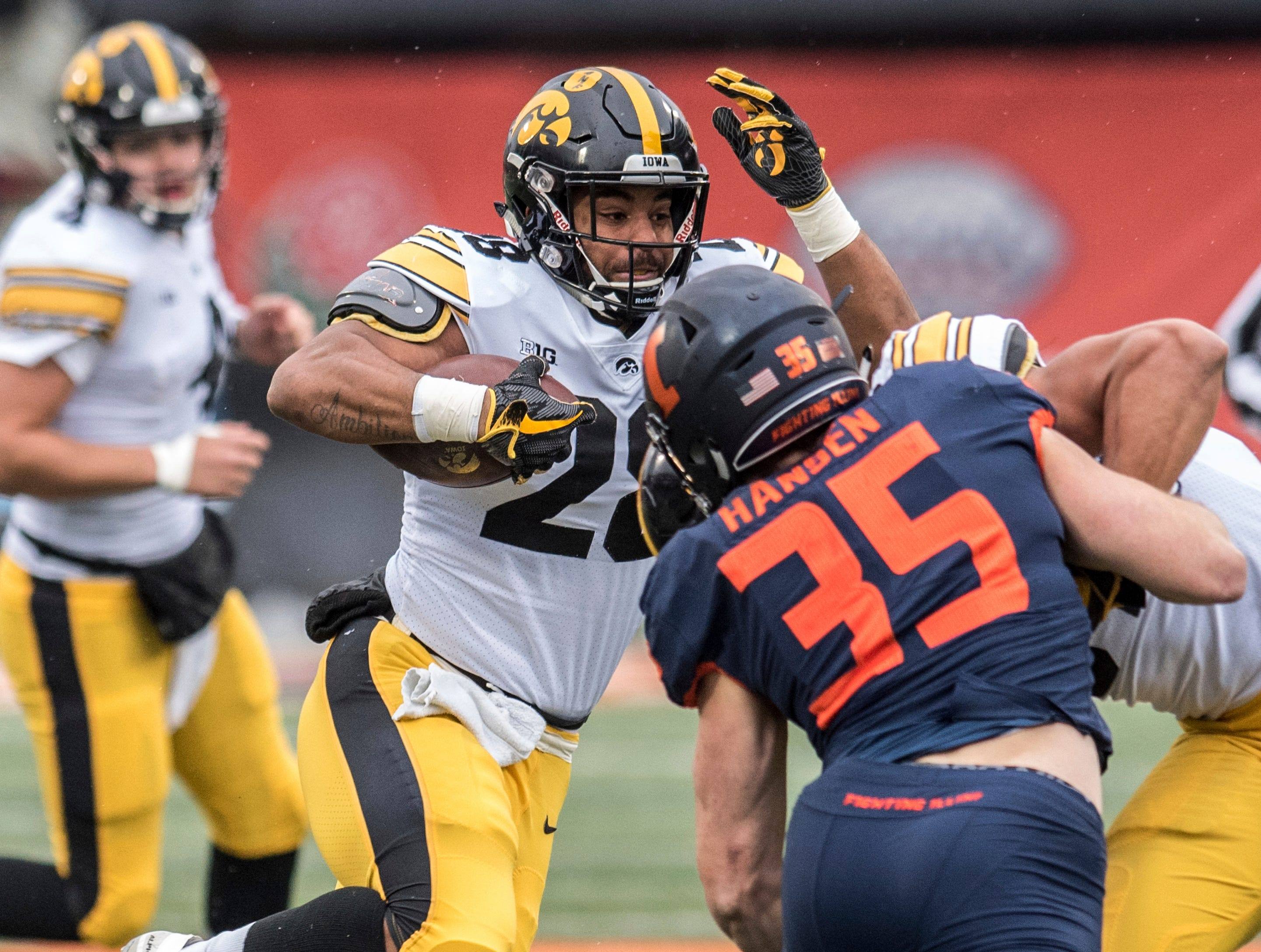 Iowa's Toren Young (28) runs the ball in the first half of a NCAA college football game against Illinois, Saturday, Nov. 17, 2018, in Champaign, Ill.