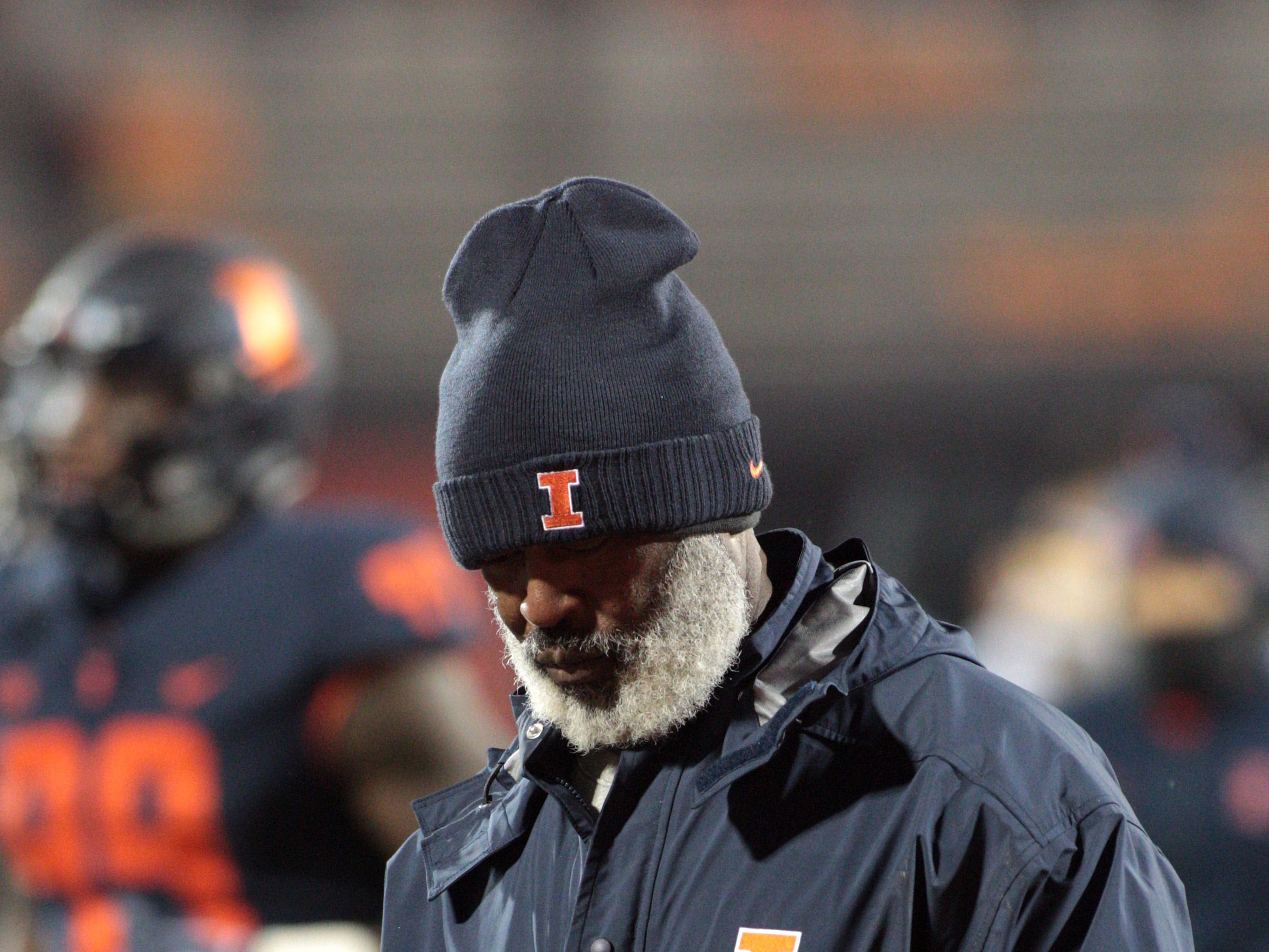 Nov 17, 2018; Champaign, IL, USA; Illinois Fighting Illini head coach Lovie Smith walks off the field during after losing to the Iowa Hawkeyes at Memorial Stadium.