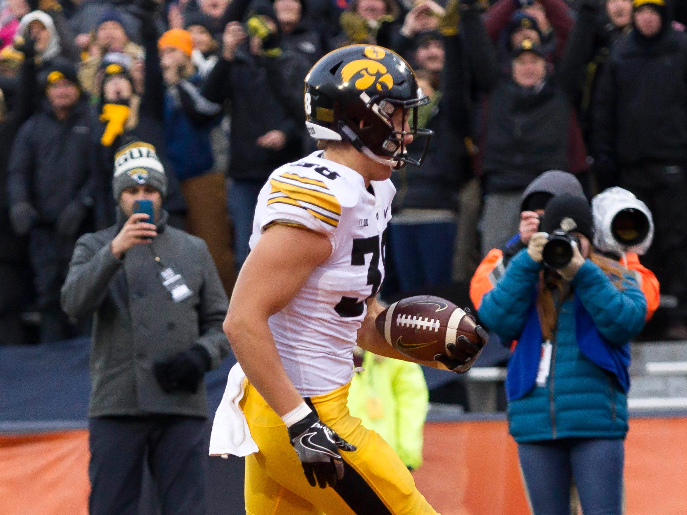 Nov 17, 2018; Champaign, IL, USA; Iowa Hawkeyes tight end T.J. Hockenson (38) scores a touchdown during the second quarter against the Illinois Fighting Illini at Memorial Stadium.