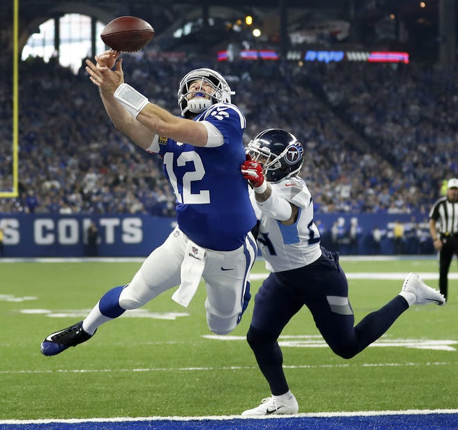 Indianapolis Colts quarterback Andrew Luck (12) makes a diving effort to catch this pass in the end zone for a touchdown but fails as he is defended by Tennessee Titans strong safety Kenny Vaccaro (24) in the first half of their game at Lucas Oil Stadium on Sunday, Nov. 18, 2018.
