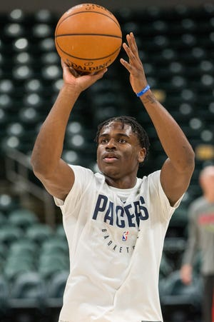 Pacers guard Aaron Holiday (3) shoots the ball during warm ups before the game Atlanta Hawks at Bankers Life Fieldhouse.