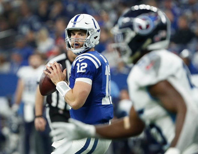 Indianapolis Colts quarterback Andrew Luck (12) drops back to pass on the Tennessee Titans defense in the first half of their game at Lucas Oil Stadium on Sunday, Nov. 18, 2018.