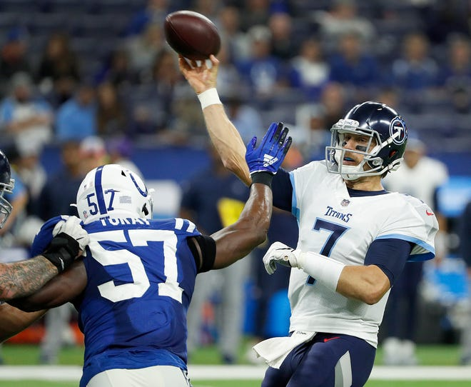 Tennessee Titans quarterback Blaine Gabbert (7) is pressured by Indianapolis Colts defensive end Kemoko Turay (57) in the second half of the game at Lucas Oil Stadium on Sunday, Nov. 18, 2018. The Colts defeated the Titans 38-10.