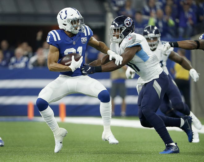 Indianapolis Colts cornerback Quincy Wilson (31) intercepts a pass intended for Tennessee Titans tight end Jonnu Smith (81) in the first half of their game at Lucas Oil Stadium on Sunday, Nov. 18, 2018.