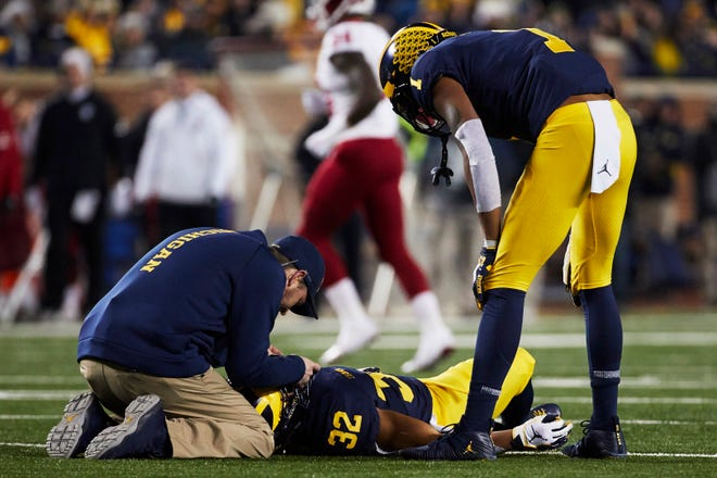 Michigan Wolverines running back Berkley Edwards (32) is checked on by the medical staff after he is injury during a kick return in the second half against the Indiana Hoosiers at Michigan Stadium. Mandatory Credit: Rick Osentoski-USA TODAY Sport