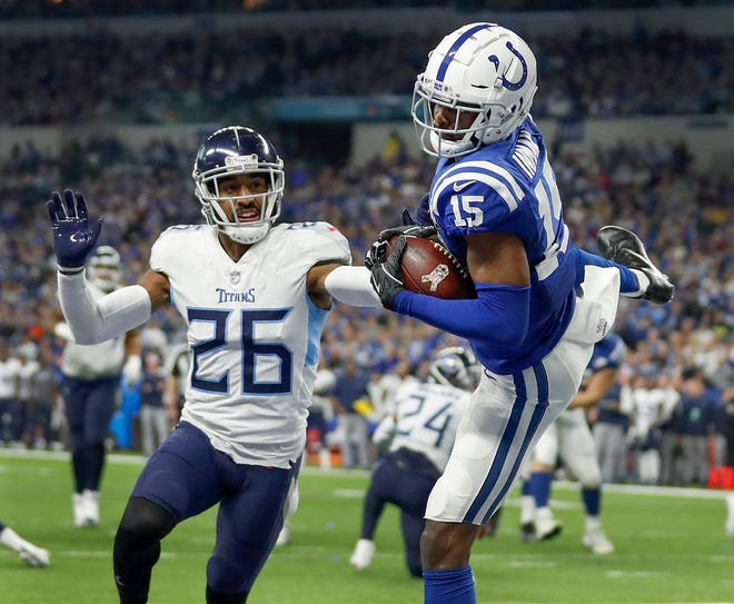 Indianapolis Colts wide receiver Dontrelle Inman (15) makes a touchdown catch behind Tennessee Titans cornerback Logan Ryan (26) in the second half of the game at Lucas Oil Stadium on Sunday, Nov. 18, 2018. The Colts defeated the Titans 38-10.