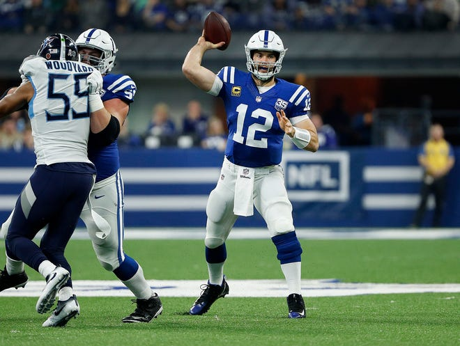 Indianapolis Colts quarterback Andrew Luck (12) gets a pass away in the first half of their game at Lucas Oil Stadium on Sunday, Nov. 18, 2018.