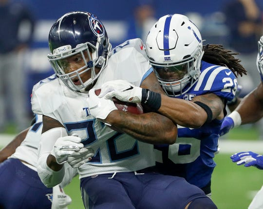 Indianapolis Colts strong safety Clayton Geathers (26) hits Tennessee Titans running back Derrick Henry (22) in the second half of the game at Lucas Oil Stadium on Sunday, Nov. 18, 2018. The Colts defeated the Titans 38-10.