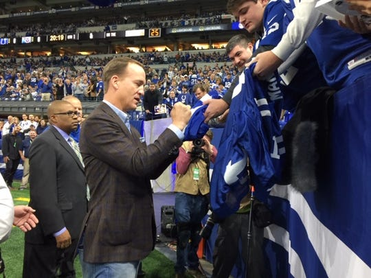 Indianapolis Colts legend Peyton Manning signs autographs at Lucas Oil Stadium on Nov. 18, 2018.