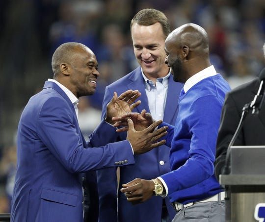 Former Indianapolis Colts Reggie  Wayne hugs Marvin Harrison as he is inducted into the Colts Ring of Honor during halftime of the Colts game against the Tennessee Titans at Lucas Oil Stadium on Sunday, Nov. 18, 2018.