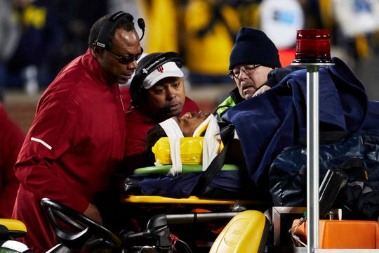 Nov 17, 2018; Ann Arbor, MI, USA; Michigan Wolverines running back Berkley Edwards (32) is carted off the field after he is injury during a kick return in the second half against the Indiana Hoosiers at Michigan Stadium. Mandatory Credit: Rick Osentoski-USA TODAY Sports