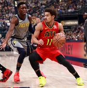 Atlanta Hawks guard Trae Young (11) dribbles while defended by Indiana Pacers guard Victor Oladipo during the first half of an NBA basketball game, Saturday, Nov. 17, 2018, in Indianapolis. (AP Photo/R Brent Smith)