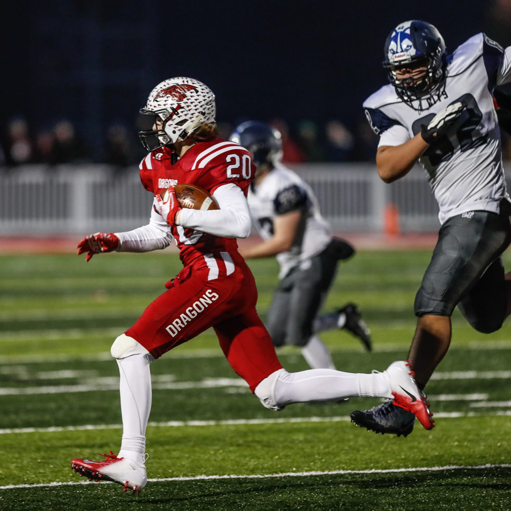 New Palestine High School's Maxen Hook (20), intercepts a pass during the IHSAA Class 5A semistate game between New Palestine High School and Michigan City High School at New Pal. on Saturday, Nov. 17, 2018.