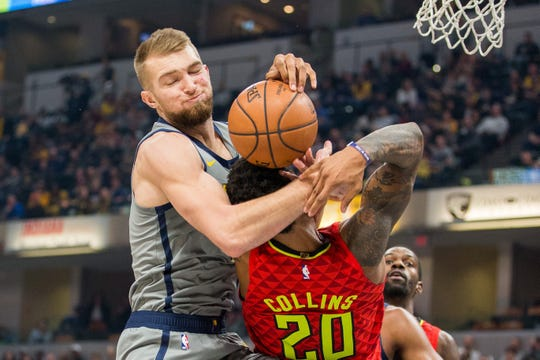 Nov 17, 2018; Indianapolis, IN, USA; Indiana Pacers forward Domantas Sabonis (11) rebounds the ball over Atlanta Hawks forward John Collins (20) in the first quarter at Bankers Life Fieldhouse. Mandatory Credit: Trevor Ruszkowski-USA TODAY Sports