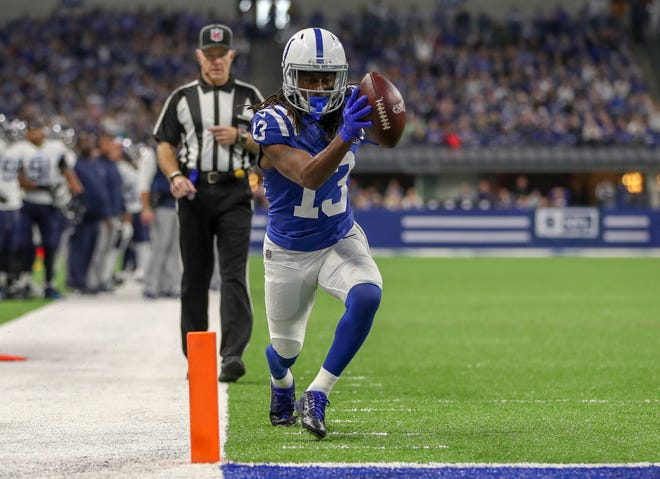 Indianapolis Colts wide receiver T.Y. Hilton (13) is able to stay in bounds and get past a tackle by Tennessee Titans cornerback Adoree' Jackson (25) for the touchdown at Lucas Oil Stadium in Indianapolis, on Sunday, Nov. 18, 2018.
