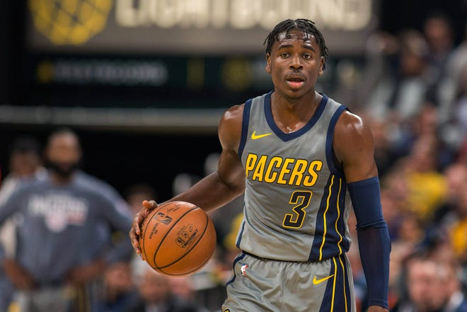 Nov 17, 2018; Indianapolis, IN, USA; Indiana Pacers guard Aaron Holiday (3) dribbles the ball in the second half against the Atlanta Hawks at Bankers Life Fieldhouse. Mandatory Credit: Trevor Ruszkowski-USA TODAY Sports