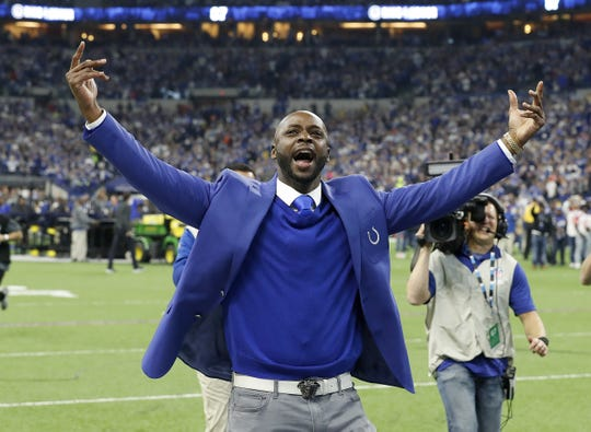 Former Indianapolis Colts Reggie Wayne greets his fans in the Northeast corner of the stadium after he  was inducted into the Colts Ring of Honor during halftime of the Colts game against the Tennessee Titans at Lucas Oil Stadium on Sunday, Nov. 18, 2018.