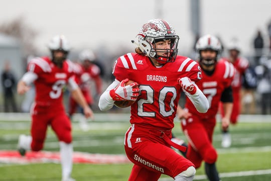 New Palestine High School's Maxen Hook (20) runs the ball for a touchdown during the I.H.S.A.A class 5A Semi-state game between New Palestine High School and Michigan City High School on Saturday, Nov. 17, 2018.