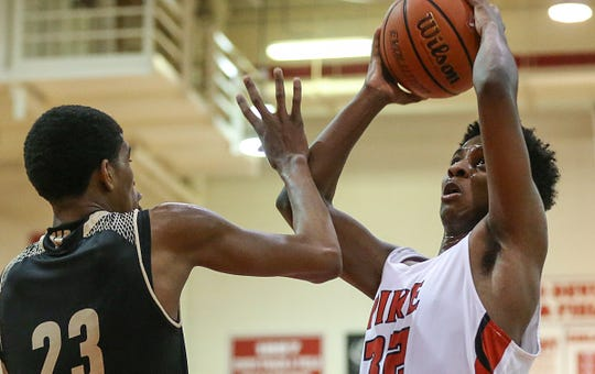 Pike's Chris Robinson (32) is a key returning piece for the Red Devils.